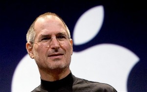 Steve Jobs rules for success led him to the top. Here he is at an Apple event, standing in front of the Apple logo.